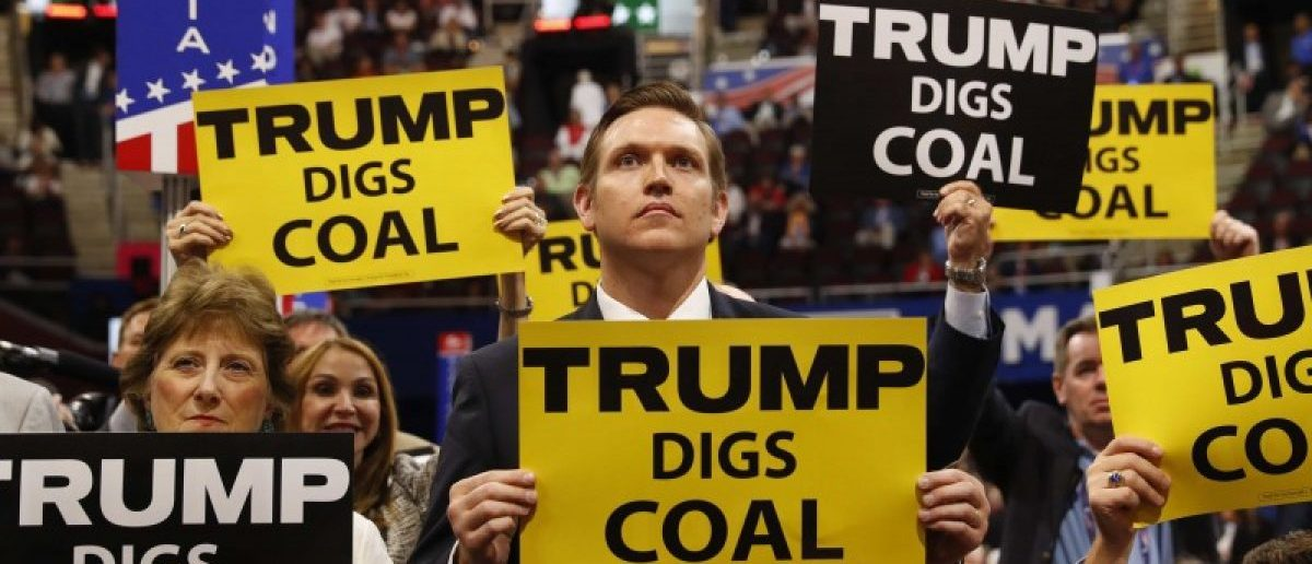 Delegates from West Virginia hold signs supporting coal on the second day of the Republican National Convention in Cleveland, Ohio