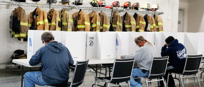 Voters fill out their ballots on election day for the U.S. presidential election at Elevation Fire Station in Benson, North Carolina November 8, 2016. REUTERS/Chris Keane
