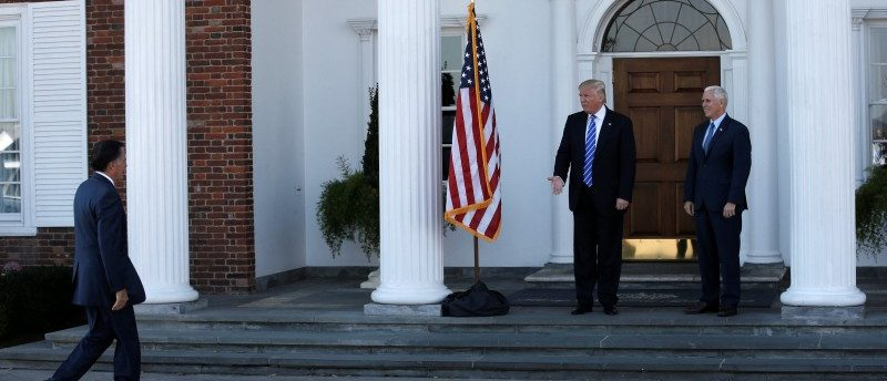 U.S. President-elect Donald Trump and Vice President-elect Mike Pence (R) greet former Massachusetts Governor Mitt Romney (L) as he arrives for their meeting at the the main clubhouse at Trump National Golf Club in Bedminster, New Jersey, U.S., November 19, 2016. REUTERS/Mike Segar