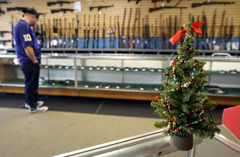 A Christmas tree sits on the counter at the Pony Express Firearms shop in Parker, Colorado December 7, 2015. REUTERS/Rick Wilking/File Photo