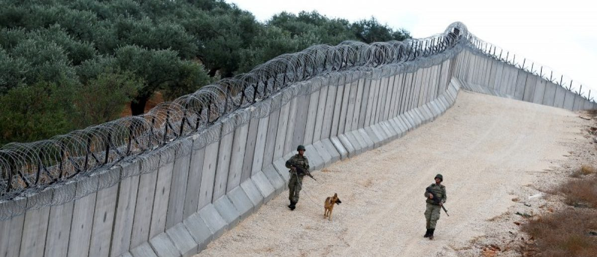 File picture of a K9 unit patrolling along a wall on the border line between Turkey and Syria, near the southeastern village of Besarslan in Hatay province