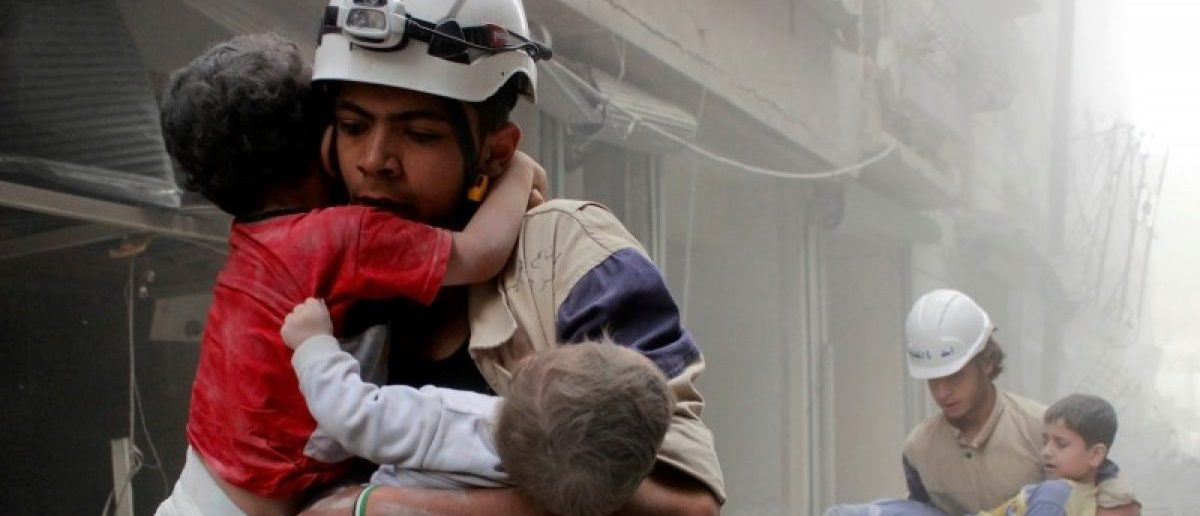 Members of the Civil Defence rescue children after what activists said was an air strike by forces loyal to Syria's President Bashar al-Assad in al-Shaar neighbourhood of Aleppo, Syria June 2, 2014. REUTERS/Sultan Kitaz