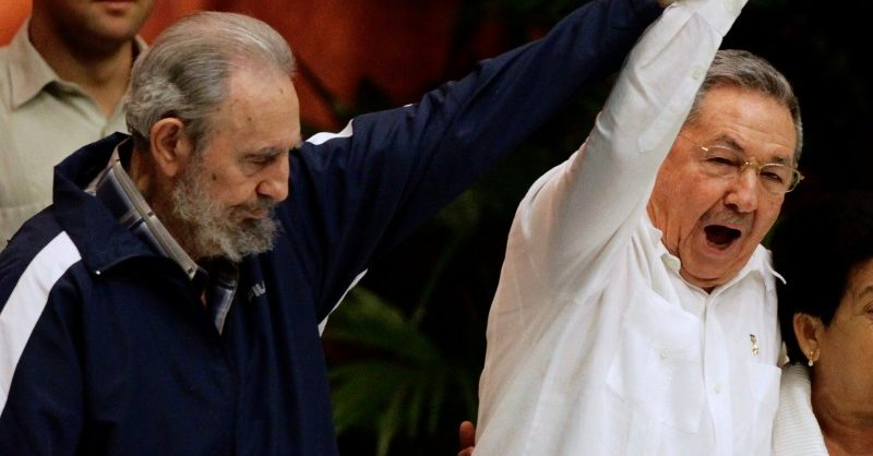 Former Cuban leader Fidel Castro (L) holds up the arm of his brother, Cuba's President Raul Castro, during the closing ceremony of the sixth Cuban Communist Party (PCC) congress in Havana in this April 19, 2011 file photo.  REUTERS/Desmond Boylan/File Photo