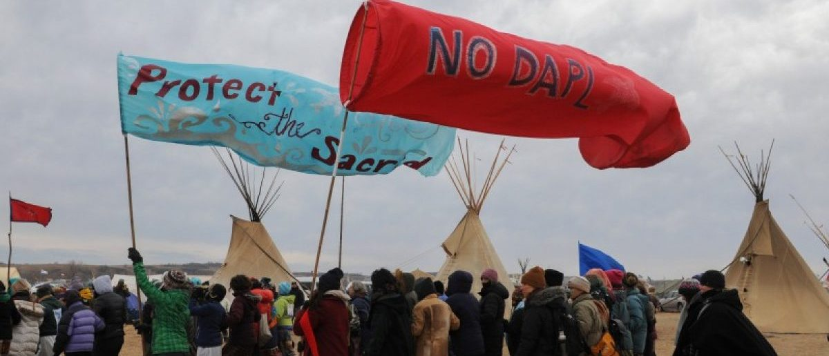 People march in Oceti Sakowin camp during a protest against plans to pass the Dakota Access pipeline near the Standing Rock Indian Reservation, near Cannon Ball, North Dakota, U.S.