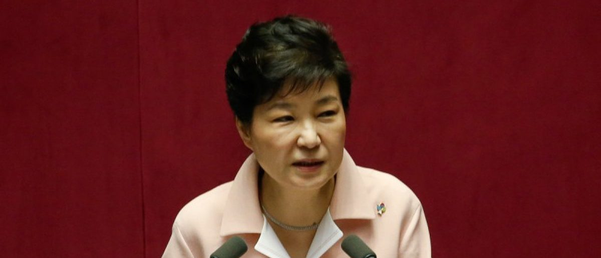 South Korea's president says that she is willing to resign rather than face  impeachment over her alleged involvement in a serious scandal.