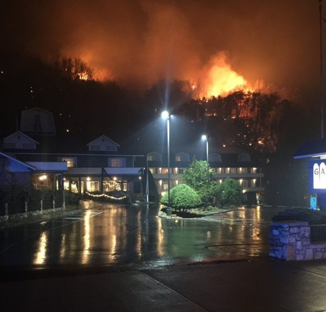 A wildfire burns on a hillside after a mandatory evacuation was ordered in Gatlinburg, Tennessee in a picture released November 30, 2016. Tennessee Highway Patrol/Handout via REUTERS