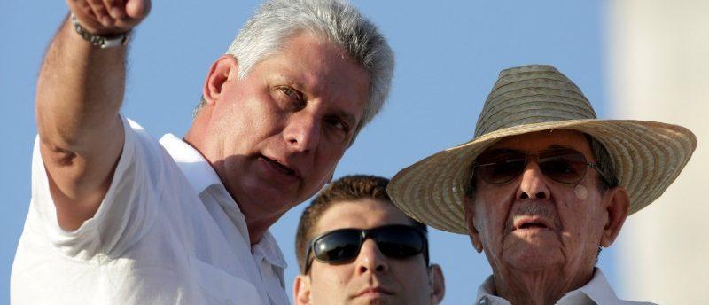 Cuban Vice President Miguel Diaz-Canel talks to Cuba's President Raul Castro in Havana