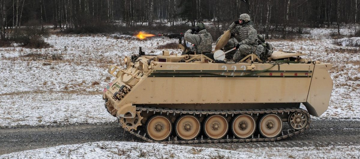 U.S. Army Soldiers, assigned to Bravo Company, 1st Battalion, 4th Infantry Regiment, engage a target from a M113A2 armored vehicle during squad maneuver training at Grafenwoehr Training Area on Jan. 14, 2013. The Soldiers of 1-4 Infantry are U.S. Army Europe's professional opposing force for training at the 7th Army Joint Multinational Readiness Center in Hohenfels, Germany. They routinely hone their skills at Grafenwoehr's multi-functional live-fire facilities. U.S. Army photo by Staff Sergeant Pablo N. Piedra
