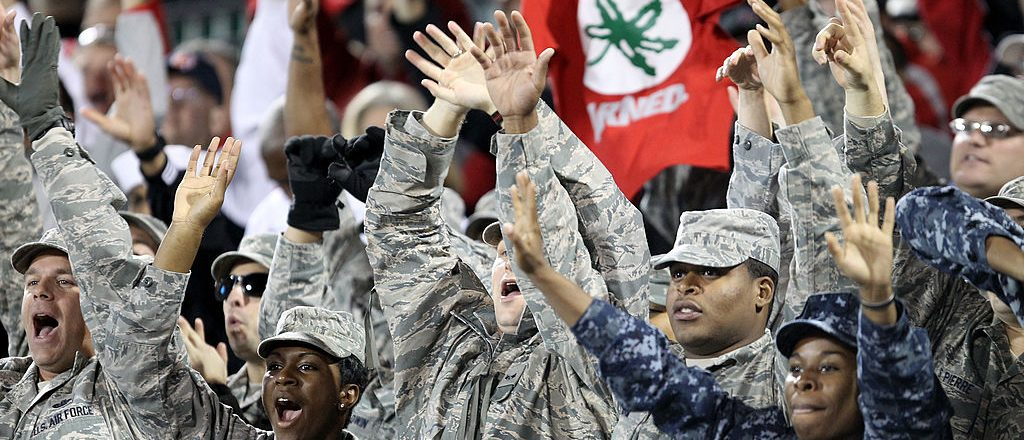 Members of the Military Armed Forces cheer as the Notre Dame Fighting Irish play against the Ohio State Buckeyes during the Walmart Carrier Classic on the deck of the USS Yorktown on November 9, 2012 in Charleston, South Carolina. (Photo by Streeter Lecka/Getty Images)