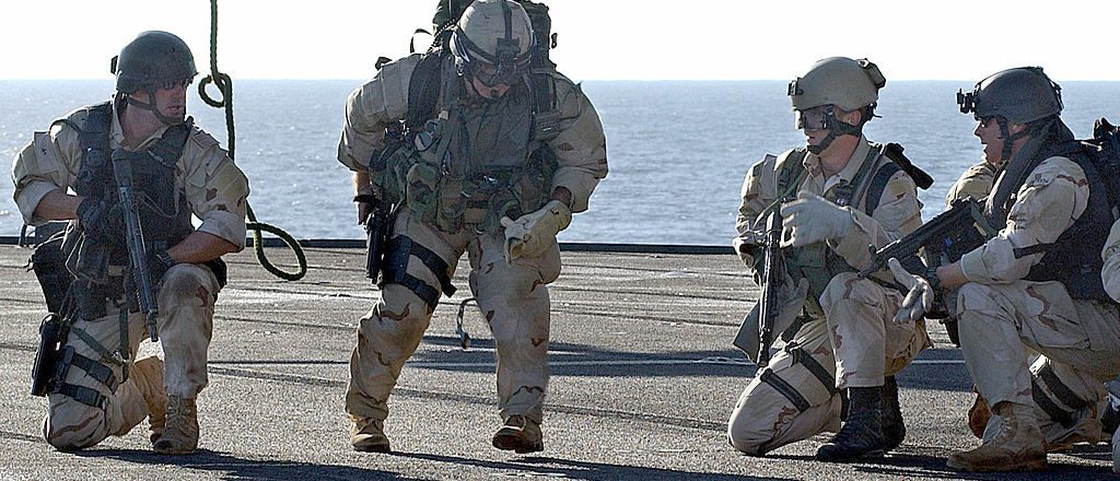 U.S. Navy SEALS complete board the deck of the amphibious command ship USS Mount Whitney from a helicopter (Getty Images)