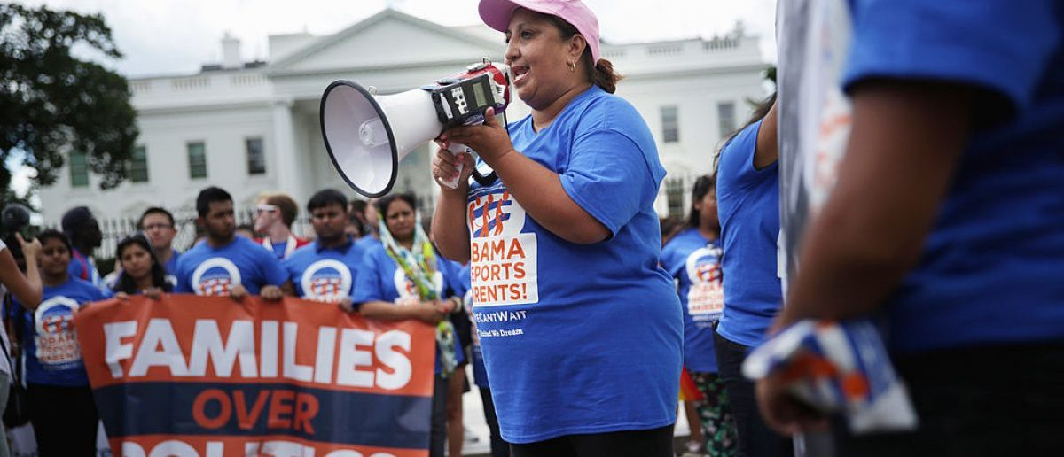 "WASHINGTON, DC - JULY 28:  Activist Ingrid Vaca of Arlington, Virginia, who was originally from Bolivia, participates in an United We Dream rally in front of the White House July 28, 2014 in Washington, DC. The activists urged President Obama not to deport the parents of DREAMers, children who brought illegally to the U.S. and eligible for the Obama Administrations ""Dream Act"" initiative .  (Photo by Alex Wong/Getty Images)"