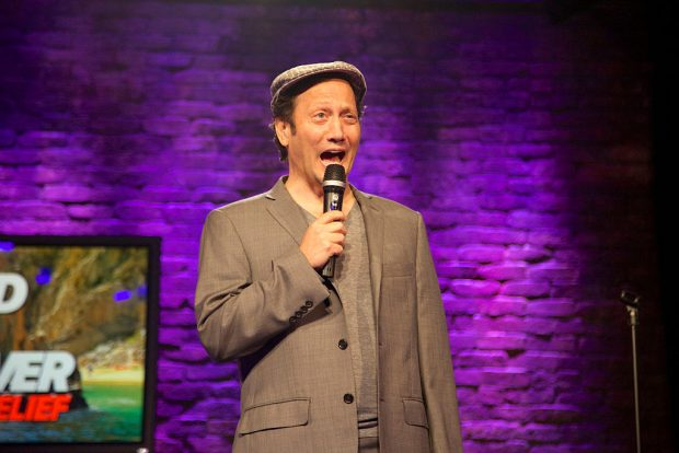 """Rob Schneider performs onstage at the NUVOtv and Levity Entertainment October 1st """"Stand Up & Deliver Cabo Relief"""" event benefiting Hurricane-Devastated Cabo San Lucas held at the Irvine Improv on October 1, 2014 in Irvine, California. (Photo by Rochelle Brodin/Getty Images for NUVOtv)"""