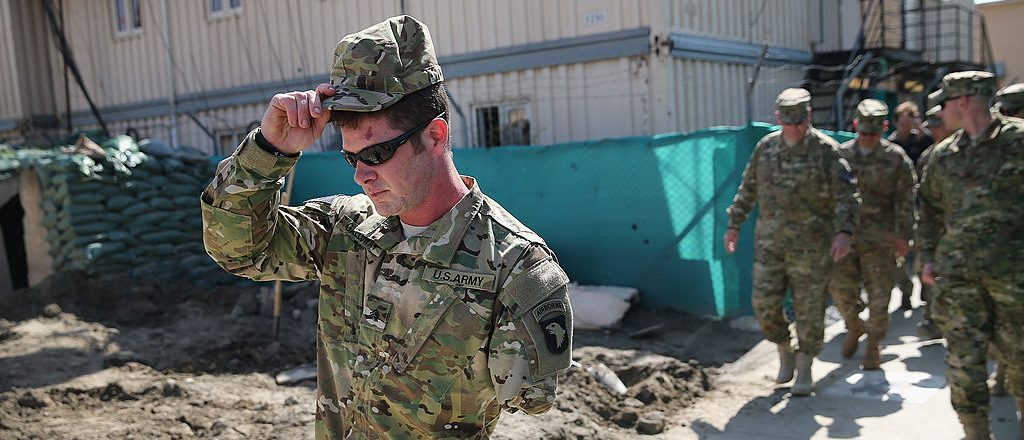 U.S. Army SGT (retired) Noah Galloway from Birmingham, Alabama tours FOB Fenty on March 12, 2014 near Jalalabad, Afghanistan. Galloway lost an arm and a leg to an IED blast in Iraq in December 2005. He was one of five wounded soldiers visiting Afghanistan with the Troops First Operation Proper Exit program. The program brings wounded servicemen back to Iraq and Afghanistan to help them come to terms with their injuries. (Photo by Scott Olson/Getty Images)