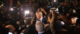 CLEVELAND, OH - AUGUST 06:  Republican presidential candidate Donald Trump (C) talks to reporters in the 'Spin Alley' after the first prime-time presidential debate hosted by FOX News and Facebook at the Quicken Loans Arena August 6, 2015 in Cleveland, Ohio. The top-ten GOP candidates were selected to participate in the debate based on their rank in an average of the five most recent national political polls.  (Photo by Scott Olson/Getty Images)