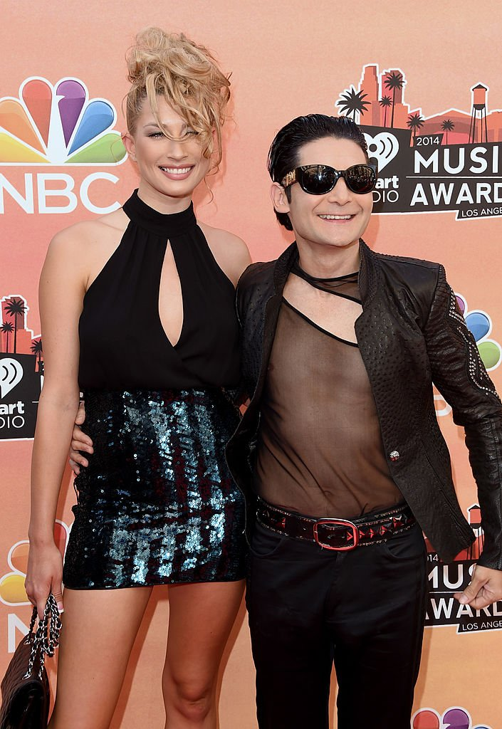 Model Courtney Anne and actor Corey Feldman attend the 2014 iHeartRadio Music Awards. (Photo by Jason Merritt/Getty Images for Clear Channel)