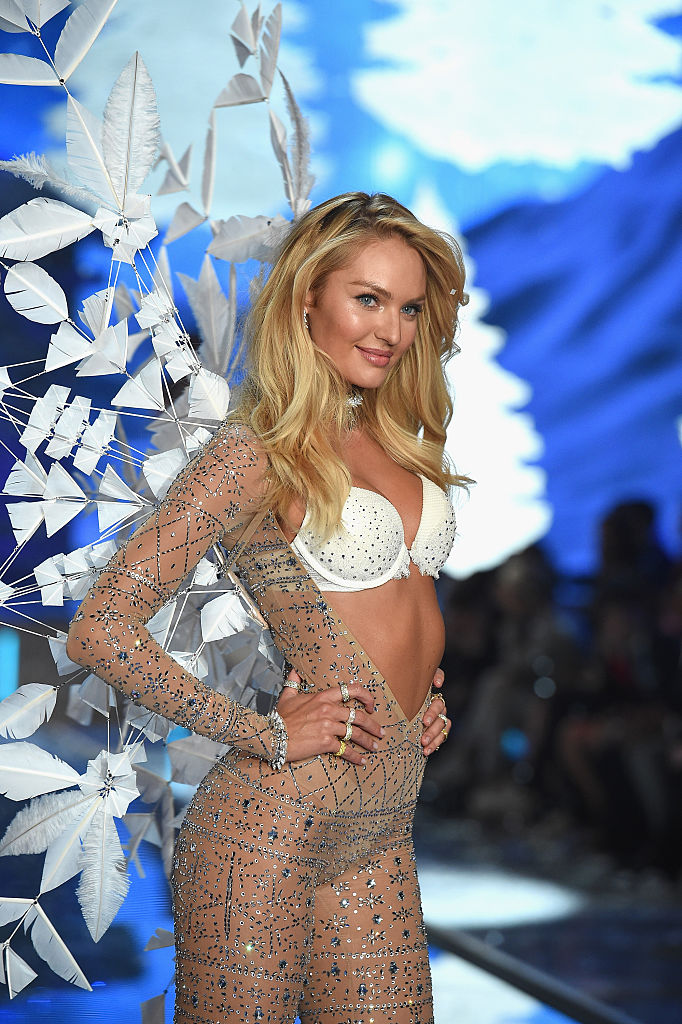 Candice strikes a pose at the end of the runway. (Photo credit: Getty Images)