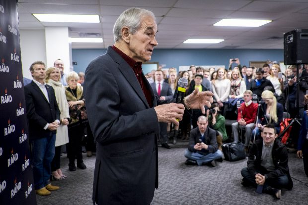 DES MOINES, IA - FEBRUARY 1: Former Congressman Ron Paul introduces his son, Senator Rand Paul (R-TX) during a caucus day rally at the Des Moines campaign headquarters on February 1, 2016 in Des Moines, Iowa. The Presidential hopeful was accompanied by his wife, Kelly, mother, Carol Wells and his father, former Congressman Ron Paul. Pauls were there to thank all the staff and volunteers for all their hard work in Iowa. (Photo by Pete Marovich/Getty Images)