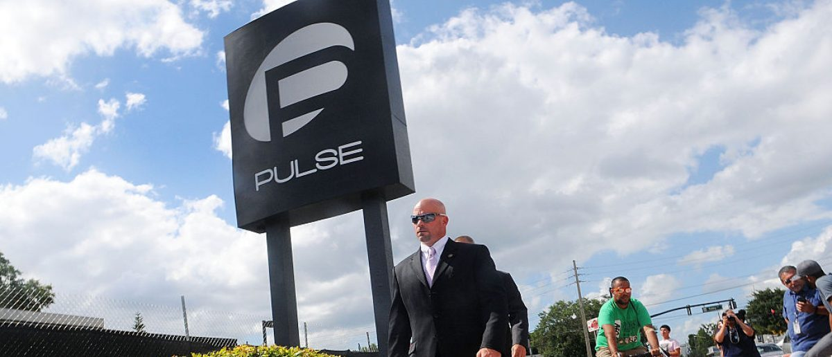 ORLANDO, FLORIDA - JUNE 21: FBI agent Ronald Hopper walks in front of the Pulse nightclub. (Photo by Gerardo Mora/Getty Images)