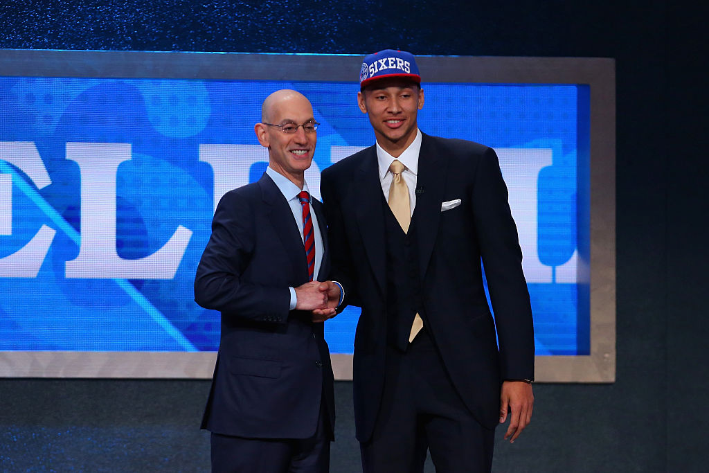 Ben Simmons poses with Commissioner Adam Silver after being drafted first overall by the Philadelphia 76ers. (Photo by Mike Stobe/Getty Images)