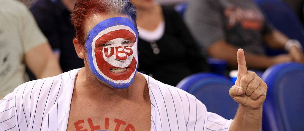A Chicago Cubs fan poses for a photo during the game against the Miami Marlins at Marlins Park on June 26, 2016 in Miami, Florida