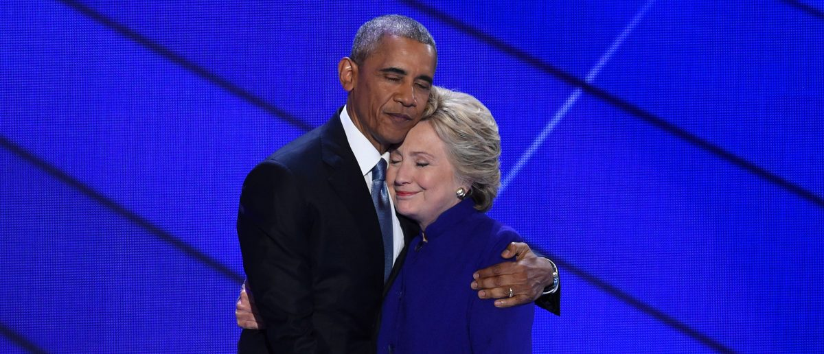 Obama and Clinton embrace on stage during the Democratic National Convention. SAUL LOEB/AFP/Getty Images