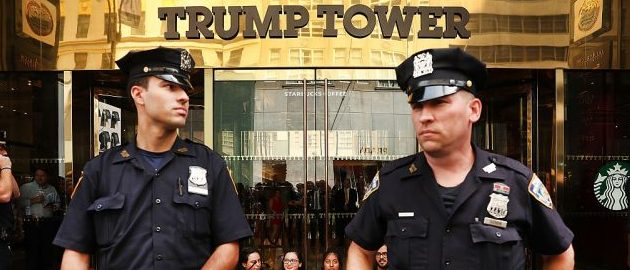 Protesters block the entrance to Trump Tower in Manhattan before being arrested on August 31, 2016 in New York City. (Photo by Spencer Platt/Getty Images)