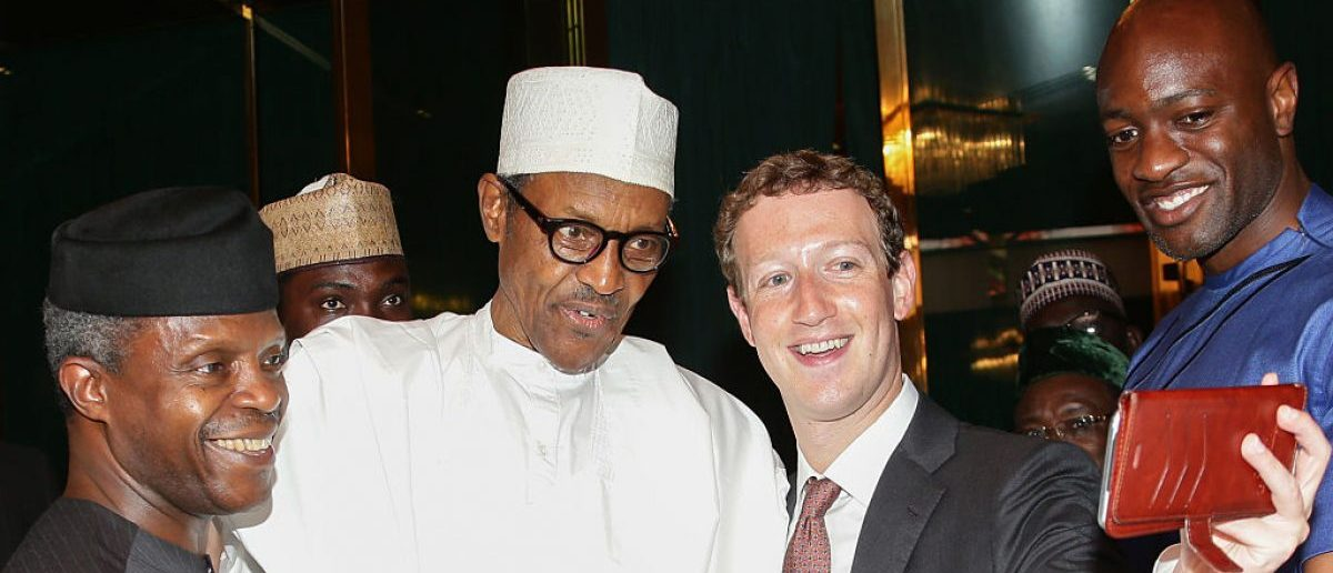 Nigerian President Muhammadu Buhari (C) and Vice President Yemi Osinbajo (L) pose as Facebook founder Mark Zuckerberg (2nd R) makes a selfie picture with them, during a visit to the presidential palace in Abuja, on September 2, 2016. [SUNDAY AGHAEZE/AFP/Getty Images]