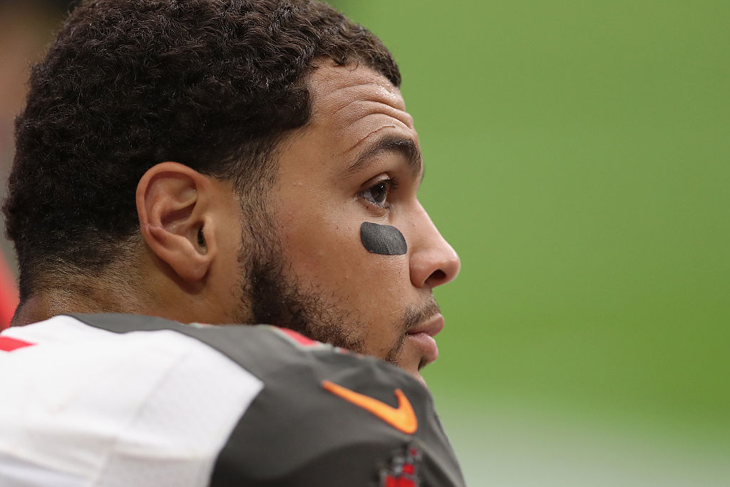 Mike Evans takes a seat on the bench (Photo credit: Getty Images)