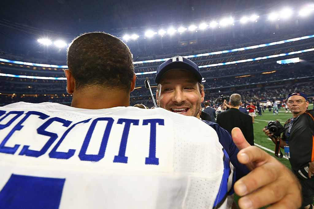 Dak Prescott #4 of the Dallas Cowboys hugs Tony Romo after a win against the Chicago Bears. (Photo by Ronald Martinez/Getty Images)