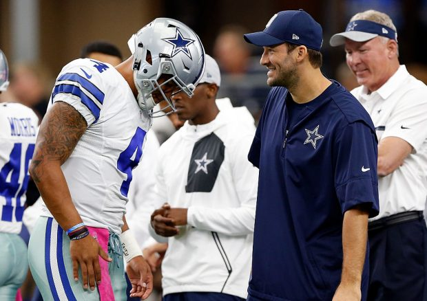 Dak Prescott, quarterback of the Dallas Cowboys talks with injured quarterback Tony Romo on the sidelines. (Photo by Wesley Hitt/Getty Images)