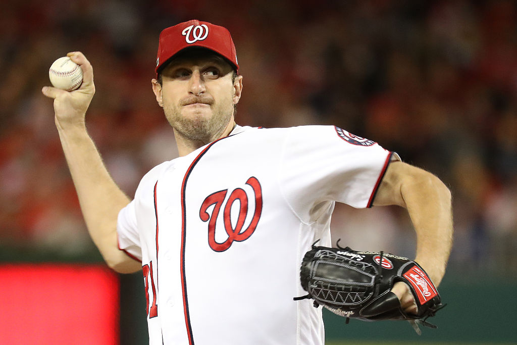 Max Scherzer #31 of the Washington Nationals works against the Los Angeles Dodgers in the fifth inning during game five of the National League Division Series at Nationals Park. (Photo by Rob Carr/Getty Images)