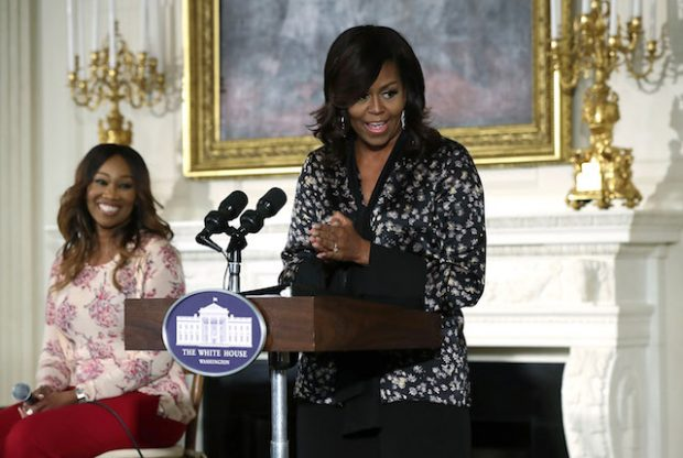 WASHINGTON, DC - OCTOBER 21: U.S. first lady Michelle Obama (R) speaks to middle school, high school and college students as singer Yolanda Adams (L) listens during an event at the State Dining Room of the White House October 21, 2016 in Washington, DC. The event is part of the ongoing series of The GRAMMY Museum musical workshops. (Photo by Alex Wong/Getty Images)