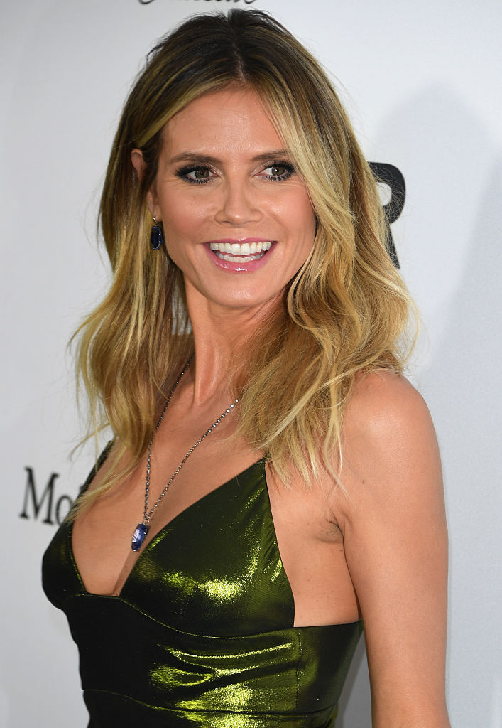 Heidi Klum looked incredible in that shiny green dress. (Photo credit: MARK RALSTON/AFP/Getty Images)