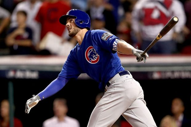 CLEVELAND, OH - NOVEMBER 01: Kris Bryant #17 of the Chicago Cubs hits a solo home run during the first inning against Josh Tomlin #43 of the Cleveland Indians in Game Six of the 2016 World Series at Progressive Field on November 1, 2016 in Cleveland, Ohio. (Photo by Elsa/Getty Images)