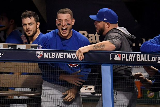 CLEVELAND, OH - NOVEMBER 02: Anthony Rizzo #44 of the Chicago Cubs reacts in the dugout after Willson Contreras #40 (not pictured) hit an RBI double to score Ben Zobrist #18 (not pictured) during the fourth inning against the Cleveland Indians in Game Seven of the 2016 World Series at Progressive Field on November 2, 2016 in Cleveland, Ohio. (Photo by Jason Miller/Getty Images)