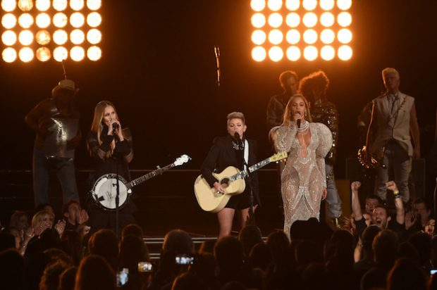 NASHVILLE, TN - NOVEMBER 02: Beyonce (R) performs onstage with Emily Robison and Natalie Maines of Dixie Chicks at the 50th annual CMA Awards at the Bridgestone Arena on November 2, 2016 in Nashville, Tennessee. (Photo by Rick Diamond/Getty Images)