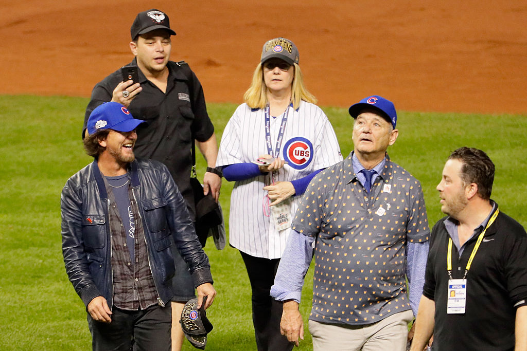 Musician Eddie Vedder and actor Bill Murray walk on the field after the Chicago Cubs defeated the Cleveland Indians 8-7 in Game Seven of the 2016 World Series. (Photo by Jamie Squire/Getty Images)
