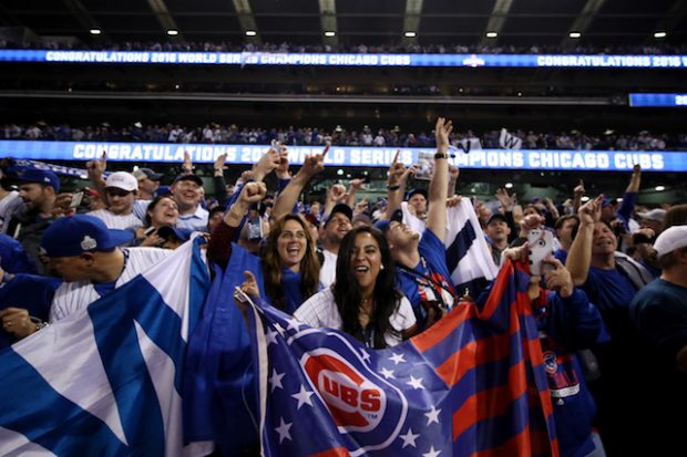 CLEVELAND, OH - NOVEMBER 02: Chicago Cubs fans celebrate after the Cubs defeated the Cleveland Indians 8-7 in Game Seven of the 2016 World Series at Progressive Field on November 2, 2016 in Cleveland, Ohio. The Cubs win their first World Series in 108 years. (Photo by Ezra Shaw/Getty Images)