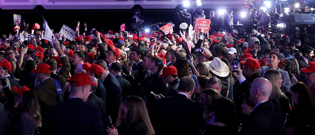 People cheer at Republican presidential nominee Donald Trump's election night event at the New York Hilton Midtown on November 8, 2016 (Getty Images)
