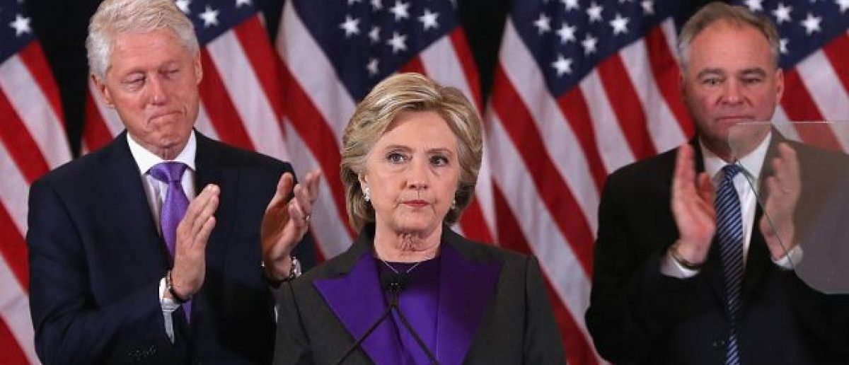 Former Secretary of State Hillary Clinton, accompanied by her husband former President Bill Clinton (L) and running mate Tim Kaine, concedes the presidential election at the New Yorker Hotel on November 9, 2016 in New York City. (Photo by Justin Sullivan/Getty Images)
