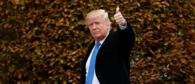 President-elect Donald Trump waves as he arrives at Trump International Golf Club for a day of meetings, November 20, 2016 in Bedminster Township, New Jersey. (Photo by Drew Angerer/Getty Images)