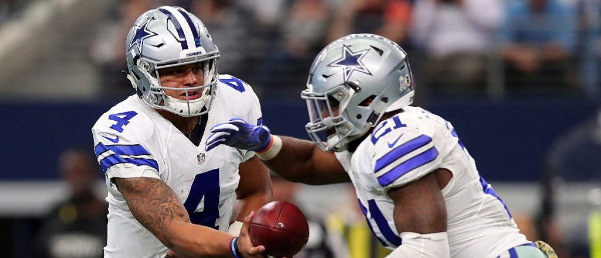 Dak Prescott #4 hands off to Ezekiel Elliott #21 of the Dallas Cowboys during the second half against the Baltimore Ravens at AT&T Stadium on November 20, 2016 in Arlington, Texas. (Photo by Tom Pennington/Getty Images)