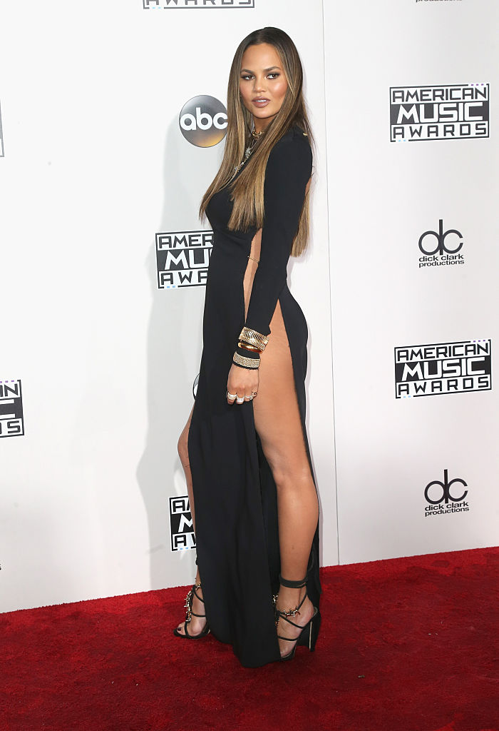 Chrissy Teigen looked incredible in this high-slit black dress. (Photo by Frederick M. Brown/Getty Images)