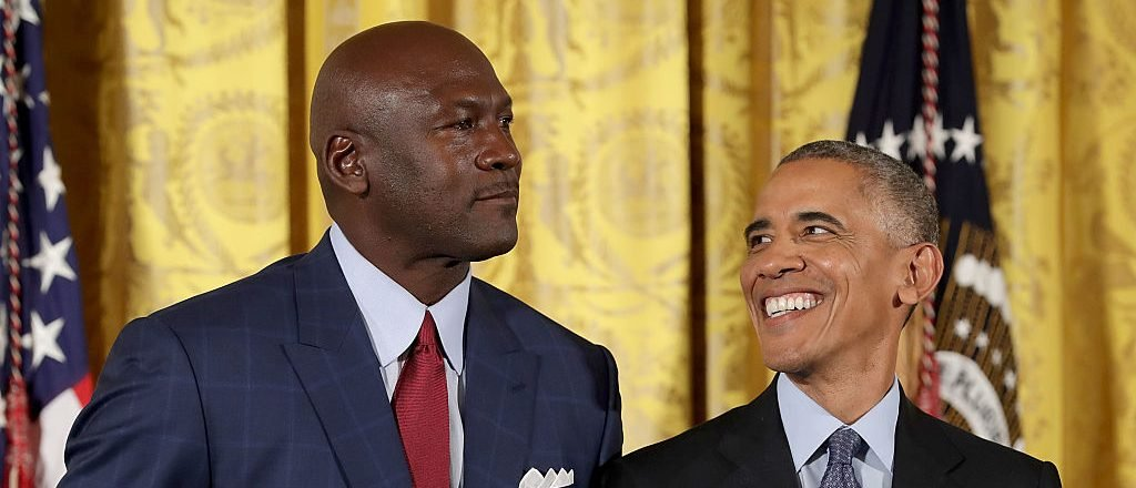 WASHINGTON, DC - NOVEMBER 22: U.S. President Barack Obama smiles up at National Basketball Association Hall of Fame member and legendary athlete Michael Jordan before awarding him with the Presidential Medal of Freedom during a ceremony in the East Room of the White House November 22, 2016 in Washington, DC. Obama presented the medal to 19 living and two posthumous pioneers in science, sports, public service, human rights, politics and the arts. (Photo by Chip Somodevilla/Getty Images)