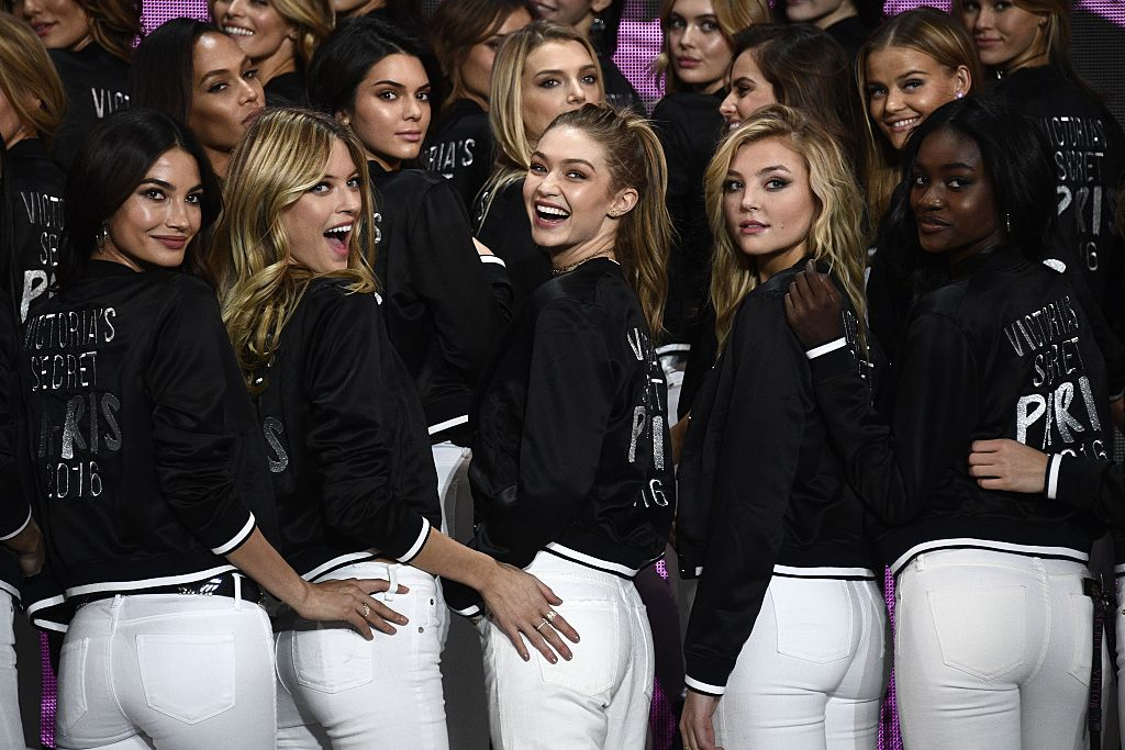Victoria's Secret models (front L-R) US model Lily Aldridge, US model Martha Hunt, US model Gigi Hadid, US model Rachel Hilbert and US model Zuri Tibby pose during a photocall at the Grand Palais in Paris on November 28, 2016 ahead of the 2016 Victoria's Secret Fashion Show. (Photo credit: MARTIN BUREAU/AFP/Getty Images)