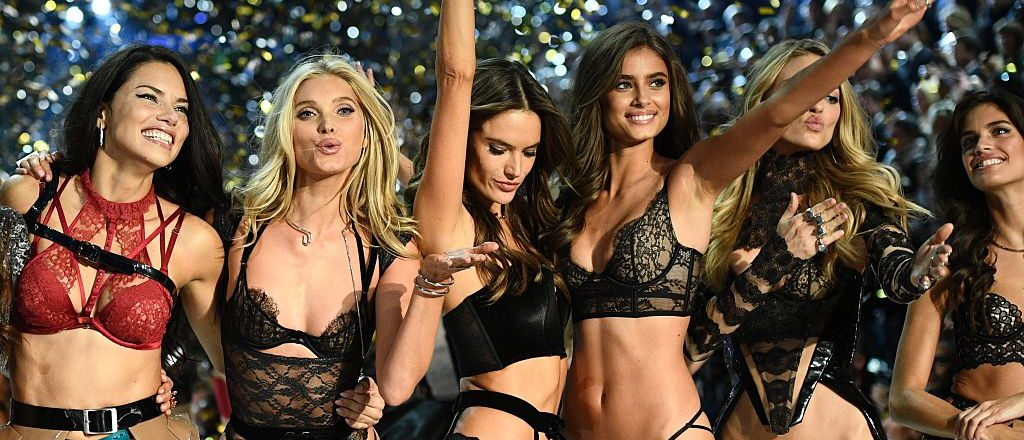 Victoria's Secret Angels (fromL) Brazilian model Adriana Lima, British model Lily Donaldson, Brazilian model Alessandra Ambrosio, US model Taylor Hill, US model Martha Hunt and Portuguese model Sara Sampaio cheer during the 2016 Victoria's Secret Fashion Show at the Grand Palais in Paris on November 30, 2016. (Photo credit: MARTIN BUREAU/AFP/Getty Images)