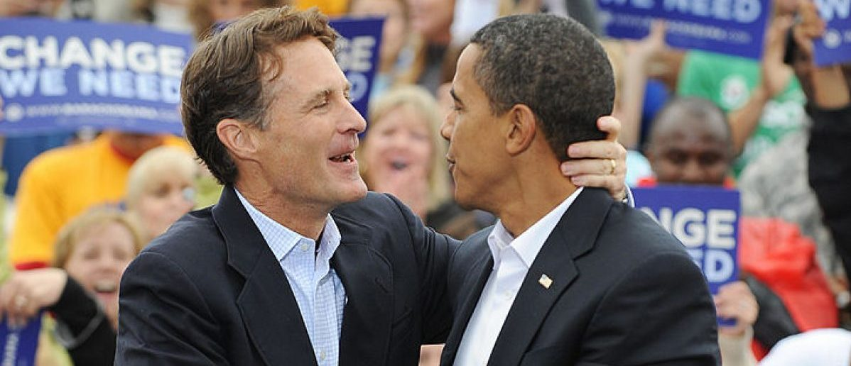 US Democratic presidential candidate Illinois Senator Barack Obama (R) is greeted by Indiana Democratic Senator Evan Bayh (L) at a rally October 8, 2008 at the Indiana State Fairgrounds in Indianapolis, Indiana. [STAN HONDA/AFP/Getty Images]