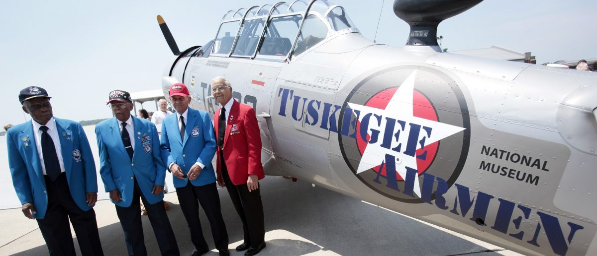 Tuskegee Airmen pilots (from L) Lt. Colonel Washington Ross, Lt. Col. Alexander Jefferson, Lt. Col. Harry Stewart and Colonel Charles McGee stand next to a Tuskegee Army Airfield AY-6 Texan fighter plane during a ceremony to honor the airmen at Selfridge National Airbase in Harrison Township, Michigan June 19, 2012.  The Tuskegee Airmen were the first African-American pilots that flew combat in World War II.   REUTERS/Rebecca Cook