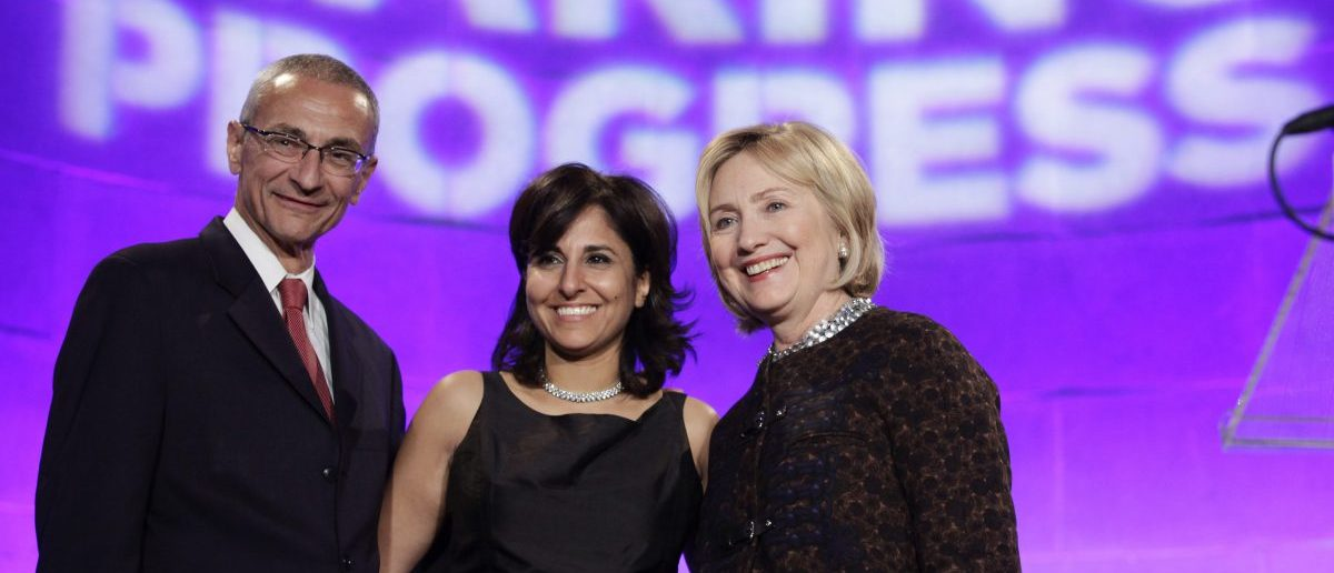 Former Secretary of State Hillary Clinton (R) poses with President of the Center for American Progress (CAP) Neera Tanden (C) and CAP founder and Chairman John Podesta at the 10th Anniversary policy forum in Washington, October 24, 2013. REUTERS/Yuri Gripas