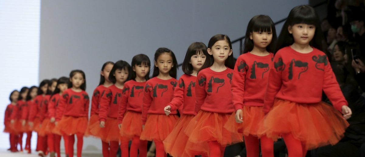 Models present creations for M.latin children's wear collection at China Fashion Week S/S 2016, in Beijing, China, October 28, 2015. REUTERS/Jason Lee